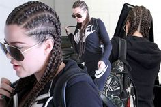 Make-up free and dressed in a full-length navy Nike tracksuit and a pair of dark shades, the gorgeous brunette could have gone incognito if it wasn't for her hair do