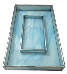 Tidy up your dresser and tabletops with one of those stained glass valets, crafted using traditional soldering techniques. The marbled blue glass is reminiscent of a dreamy blue sky with its natural swirls and streaks. Available in two sizes, the smaller one is just right for jewelry or a selection of fragrances, and the larger one can be used to hold your wallet, phone and keys near the front door.