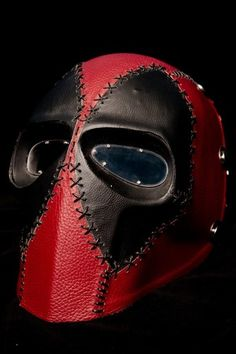 I like this mask for its black and red colours and for its stitched design