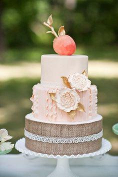 pink ruffled wedding cake with burlap