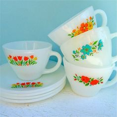 Display Vintage Fire King Floral Assorted Tea Cups with stands and holders.