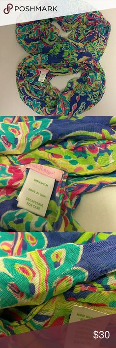 🍒Lilly Pulitzer 🍒 Infinity scarf/wrap Excellent pre-loved condition super stylish multicolored scarf/wrap in teal, pink, purple great and yellow. Perfect addition to the fashionista's wardrobe for work or play! Style# C46281 100%Rayon Made in China  Measurements: Circumference/length: 74 in   No damages or Stains. From a PET FREE & SMOKE FREE home. I aim to please and look forward to answering any questions you have. All reasonable offers considered. Lilly Pulitzer Accessories Scarves…