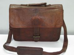 Leather Men Briefcase Messenger Laptop Bag Macbook Satchel Attache Brown Tanned Distressed Rustic Rugged Leather handbag. $99.00, via Etsy.