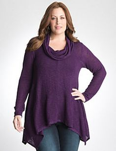 Lusciously soft and amazingly flattering, this sexy sweater by DKNY JEANS makes the most of your shape with a cowl neck and shark bite hem. Slightly sheer for trendy layering, wear this luxe top over your favorite tank and jeggings for a fashion-forward combo.
