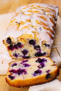 Blueberry vanilla bread with lemon glaze. This delicious bread is stuffed with b… Blueberry vanilla bread with lemon glaze. This delicious bread is stuffed with blueberries, and deliciously flavored with vanilla and lemon zest. Blueberry Recipes, Lemon Recipes, Sweet Recipes, Baking Recipes, Blueberry Lemon Bread With Glaze, Bread Recipes, Healthy Blueberry Bread, Lemon Glaze Cake, Lemon Glaze Recipe