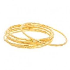 Single Stack Bangle - This gorgeous textured bangle is a must have if you are a bangle lover! This 22kt gold plated over brass bangle is great for stacking.  The inside diameter is 63mm which fits an average hand and wrist. Great for stacking with the gemstone bangle, see related products. Stack them, layer them and jangle your bangles, youll love these!