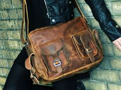 Retro inspired brown leather flight bag.  Scaramanga vintage and retro fashion and interiors.
