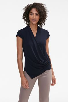 This refined top is cut with a diagonal wrap that drapes across the torso, accentuating the waist and creating an angled hem. With cap sleeves and a classic V-neck, the Ferrante works beautifully on its own or under a blazer. Work Wardrobe, Capsule Wardrobe, Wardrobe Basics, Work Fashion, High Fashion, Business Casual Dresses, Work Attire, What To Wear, Style Me
