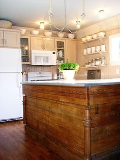 I want this for my kitchen island...someday. It's an old hardware store counter.
