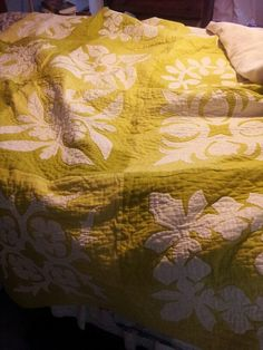 This hand appliqued and hand quilted by-the-block quilt I made for Kelsey and Zach several years ago.