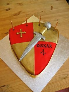 Fab for budding knights - the shield and sword cake! Knight Cake, Knight Party, Dragon Birthday, Dragon Party, 6th Birthday Parties, Birthday Cake Girls, Birthday Cakes, Sword Cake, Castle Party