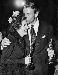 Best Actor winner Gary Cooper (Sergeant York) kisses Best Actress winner Joan Fontaine (Suspicion) at the 14th Academy Awards