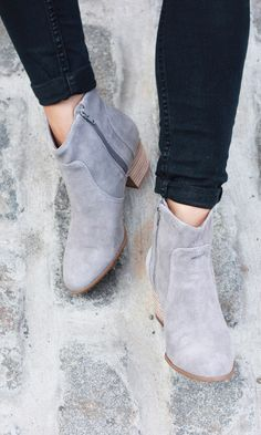 Transition easily into fall with these Western-inspired booties in grey soft suede.