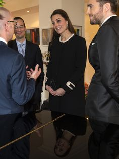 "Catherine, Duchess of Cambridge and British Consul General of New York Danny Lopez (2nd from L) chats with Simon Collins (L) , Dean of Fashion at Parsons at the New School of Design and at right is Pete Cashmore founder of the news site ""Mashable"" before a luncheon at the residence of the British Consul General during her official two-day visit to the United States on December 8, 2014 in New York City. Prince William and his wife Kate are on a visit to New York City,  that includes visits to…"