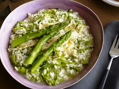 Risotto With Asparagus: This rich, comforting bowl is finished with slices of creamy Taleggio cheese. #RecipeOfTheDay