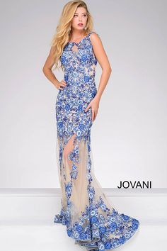 14199ad9df Blue and nude floor length dress with sheer bodice and open back.