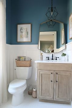 Comes : Barn Seadrift faux finish vanity, matte black hardware, and Behr Color of the Year 2019 Blueprint. See how the white board and batten in the powder room ties it all together! Modern Bathroom Design, Bathroom Interior, Amazing Bathrooms, Bathroom Colors, Modern Farmhouse Bathroom, Best Bathroom Colors, Painting Bathroom, Bathroom Decor, Small Bathroom Remodel