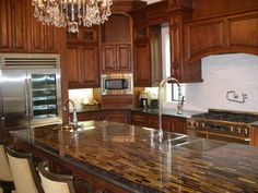 This is a Tiger Eye Granite countertop with Absolute Black Granite edges and bronze sinks. How stunning!
