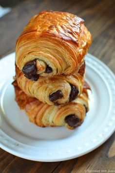 """Flakey, buttery, delicious croissant dough filled with melty dark  chocolate. A foolproof recipe for homemade """"Pain Au Chocolat"""".:"""