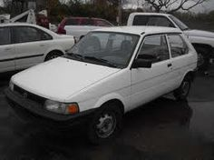 #3.White Subaru Justy - 1989? 3-cyl, 50 MPG. My first 'new' car. Drove it for maybe 10 years until the engine died.