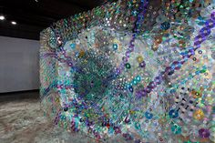 Leticia Bajuyo works almost exclusively with the nearly obsolete material. The artist, who is also an Associate Professor of Art at Hanover College, laboriously assembles thousands of donated CDs into large-scale sculptural installations that are both impossible to miss and hard to keep your eyes off of.