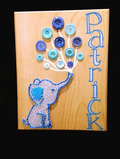 - Perfect nursery decor! - This custom piece is an 8x11 oak wood plaque with sawtooth brackets mounted on the back for easy hanging - Blue and white String Art Elephant with an array of balloon button