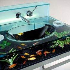 Like your pets but don't know where to put them, Bathroom sink made from a fish tank! How do you clean it though?