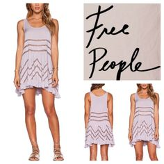 """Free People Pin Dot Trapeze Slip Dress.  NWT. Free People Lavender Pin Dot Trapeze Lace Slip Dress, 100% rayon, lace trim 100% nylon, washable, 17.5"""" armpit to armpit (35"""" all around), 31"""" shortest center length, 35"""" longest side length, unlined, sheer lace panel accents, ruffle hem, sleeveless, asymmetrical hem, pullover style, measurements are approx.  No PayPal...No Trades... Free People Dresses Mini"""