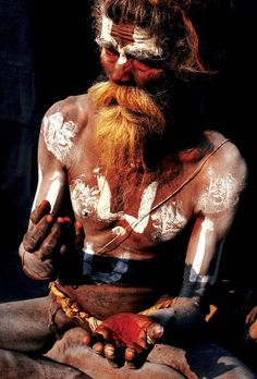 SADHU An elderly Vaishnava applies color to not only his forehead but also his chest, belly, arms, and legs. Common body markings include the disk (chakra), conch (shankha), mace (gada) and lotus (padma). Pashupatinath, Kathmandu, Nepal.