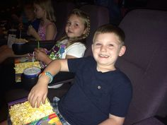 His movie date. Watching Dolphin Tale 2!