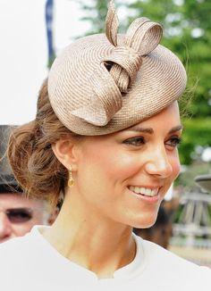 She Rocks a Fascinator: Need inspiration to make a creative fashion statement? Follow Kate's lead, and wear a fanciful fascinator.