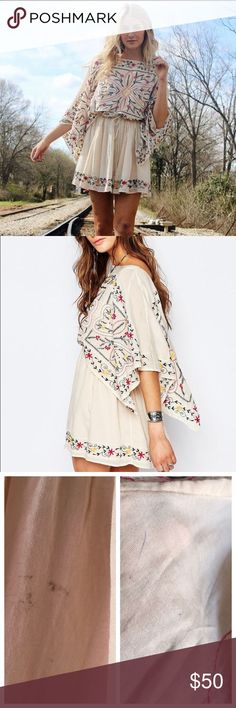 Free People Embroidered Dress Embroidered Dress by Free People in color. Size is medium. Tags still attached but small mark on skirt and back shoulder, price defects defect. They were there when purchased-- may be able to be removed; i haven't tried.   Don't forget to shop my closet for a bundle discount! Free People Dresses