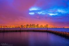 Cloudy and colorful at dawn in Beautiful San Diego, California.  Photo By Alex Baltov Photography.