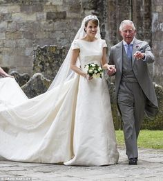 She is the daughter of Charles'close friend Lord Brabourne. Her name is Alexandra Knatchbull. Her father was too ill to walk her down the aisle on her wedding day, so Charles gave her away!