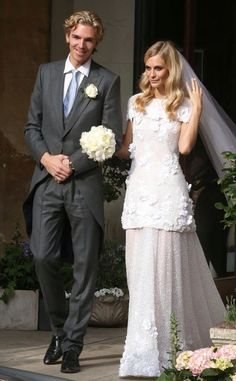 Poppy Delevigne / James Cook wedding - the bride is in a Custom made 'Chanel' gown