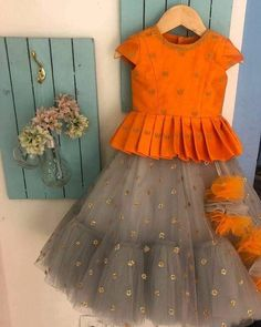 Kids designer dresses - Doll up your princess from us This spring wedding season , try something different in these trouser sarees , make yourself free Go easy… Kids Party Wear Dresses, Kids Dress Wear, Kids Gown, Little Girl Dresses, Dress Party, Summer Dresses, Girls Frock Design, Baby Dress Design, Baby Frocks Designs