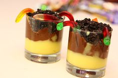 "Easy way to make ""Worms in Dirt"": Put vanilla pudding (like snack-packs) in a cup; put chocolate pudding on top; mash up some oreos and sprinkle on top. Add gummy worms. Enjoy!"