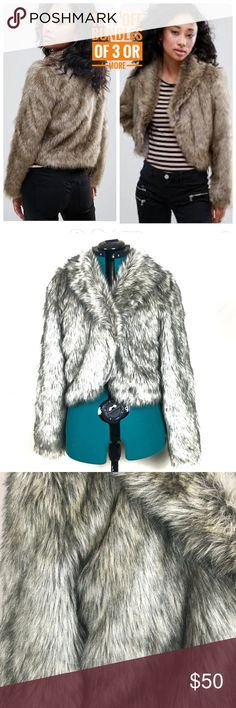 NWT urban bliss faux fur crop jacket New with tags urban bliss faux fur  crop jacket.   Size 12, measurements are approximately 21 inches pit to pit, 19 inches top to bottom  42% modacrylic 40% acrylic, 18% polyester. urban bliss Jackets & Coats