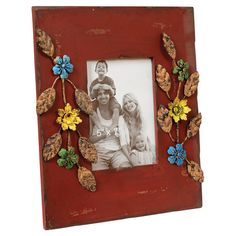 Photo frame with weathered metal flower accents.    Product: Photo frameConstruction Material: Wood and metal and glas...