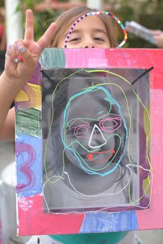 Crayola makes washable dry erase pencils and markers... I love them n wash off the walls easily ( we have a special pink chalkboard contact paper wall just for that). ---self portrait shadow boxes