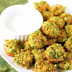 Cheese and Vegetable Quinoa Bites  2 cups cooked quinoa  2 large eggs  3 carrots, shredded  1 and 1/2 cups fresh spinach, chopped  1 medium shallot, chopped  2 teaspoons garlic  4 ounces sharp cheddar cheese, grated 2 tablespoons flour  Sea salt and pepper, to taste
