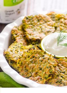 CLEAN EATING Baked Zucchini Fritters Recipe -- Made healthier with whole wheat flour and baked instead of fried. Same crispy. Baked Zucchini Fritters, Bake Zucchini, Zucchini Pancakes, Cauliflower Fritters, Side Dish Recipes, Vegetable Recipes, Vegetarian Recipes, Real Food Recipes, Cooking Recipes