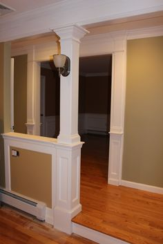 Half wall with column. For load bearing and to define foyer on enclosed front porch. Add shelves behind and put couch in front.