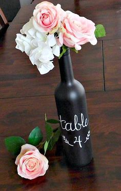 Make a statement with these wine bottle table numbers! Perfect for the wine themed wedding or shabby chic look these wine bottles are covered in