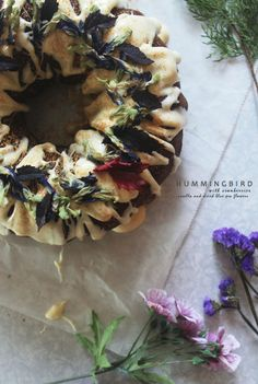 Hummingbird Bundt Cake with Cranberries, Rosella and Dried Blue Pea Flowers, and Cream Cheese Icing Pea Flower, Cream Cheese Icing, Cranberries, Hummingbird, Floral Wreath, Wreaths, Cake, Flowers, Decor
