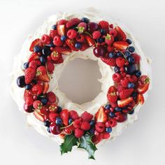Christmas Pavlova Wreath with Strawberries and Berries -TIP use honey not sugar -fill with vanilla coconut cream