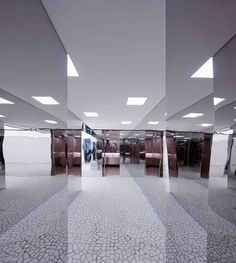 Grey Palladiana Terrazzo clads surfaces throughout this retail shop ...