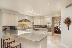 Gainey Ranch home for sale in Scottsdale, Arizona. Luxury kitchen for entertaining guests.