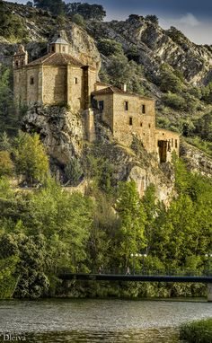 Hermitage of St. Saturius (San Saturio in Spanish)  -   Soria, Spain  -  18th century (1700s)  -  octagonal building on a cliff, beside the River Duero & above the cave where St. Saturius, patron saint of Soria, made his home