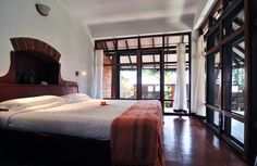 A bedroom in one of the villas
